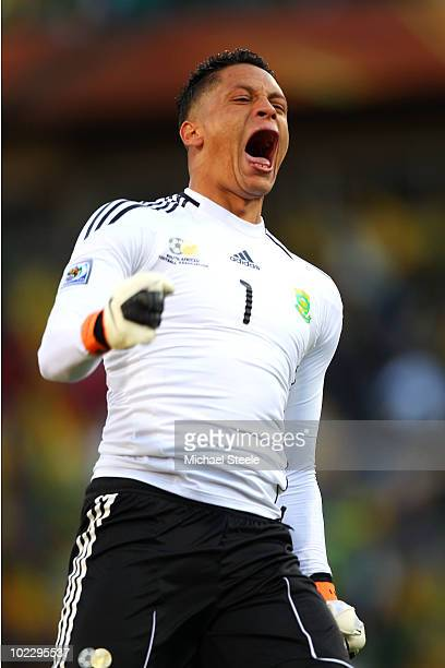 Moneeb Josephs of South Africa celebrates his team's second goal by Katlego Mphela during the 2010 FIFA World Cup South Africa Group A match between...