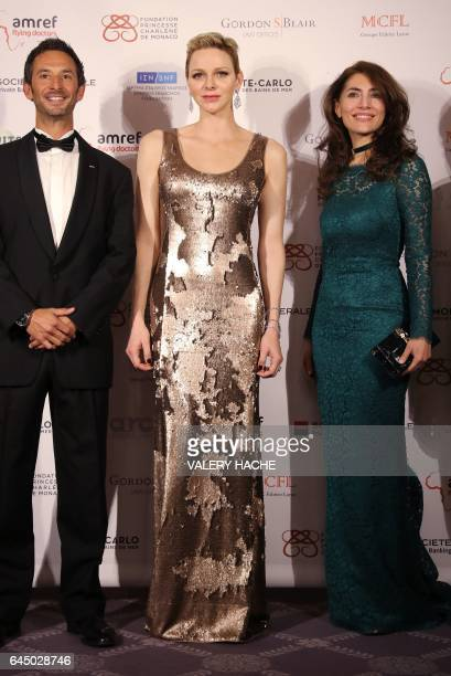Monegasque free diver Pierre Frolla Princess Charlene of Monaco and Italian actress Caterina Murino attend the AMREF gala on February 24 in Monaco /...