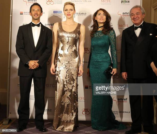 Monegasque free diver Pierre Frolla Princess Charlene of Monaco Italian actress Caterina Murino and Italian actor Remo Girone attend the AMREF gala...