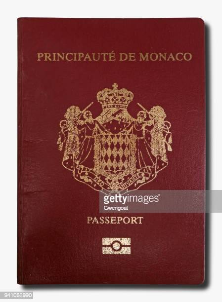 monegasque passport isolated on a white background - monaco stock pictures, royalty-free photos & images