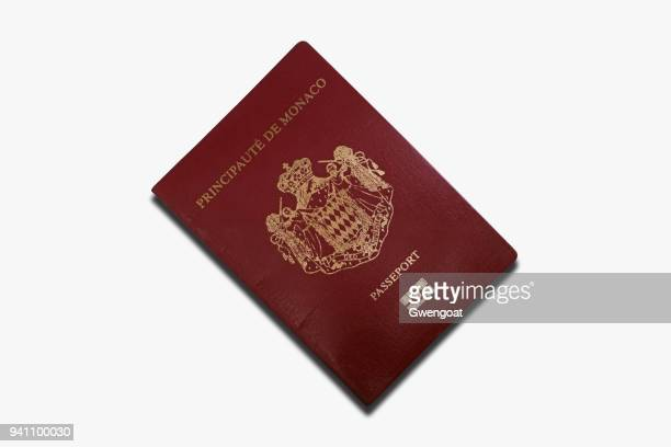 monegasque passport isolated on a white background - gwengoat stock pictures, royalty-free photos & images
