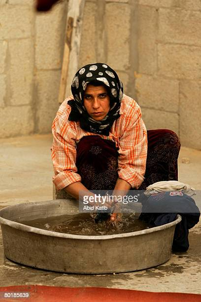 Monera AlDali the wife of the 51 yearsold unemployed refugee Palestinian man Jamal Awad AlDali who has twelve children washes clothes at their home...