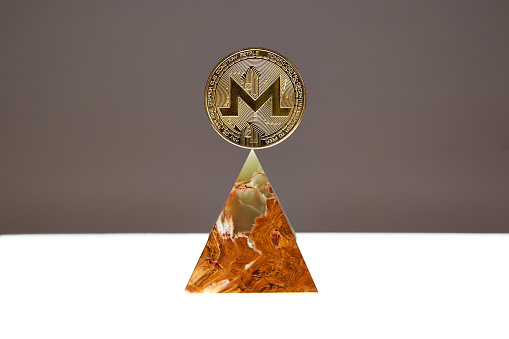 Monero Coin floating above an Onyx Stone Pyramid - gettyimageskorea