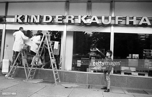 Monetary union of East and West Germany. New decorations and displays for the shop windows of a childrens shop at Alexanderplatz
