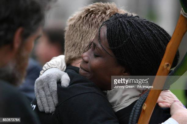 Monette Tapa Mekomou embraces a friend besides the Buxton Memorial in Victoria Tower Gardens, Westminster, central London, as they joined a Walk of...