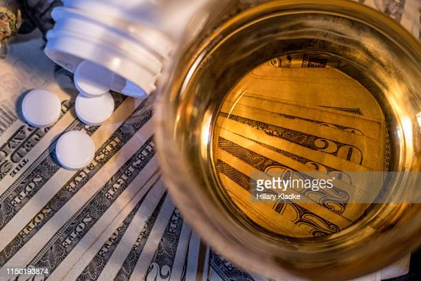 money, alcohol and drugs - fda stock photos and pictures