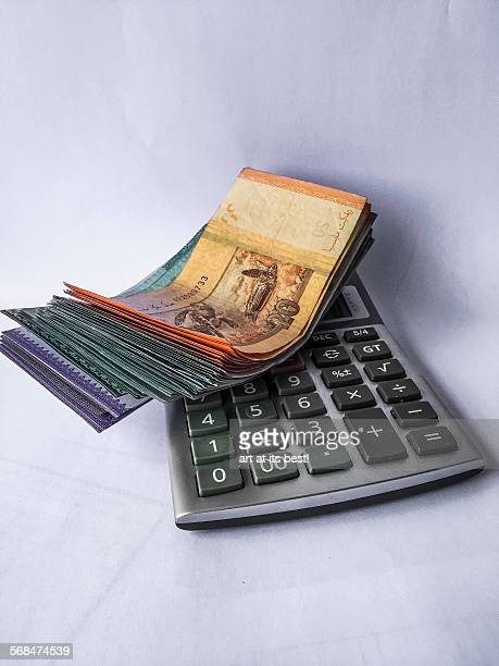 money and a calculator - malaysian ringgit stock photos and pictures