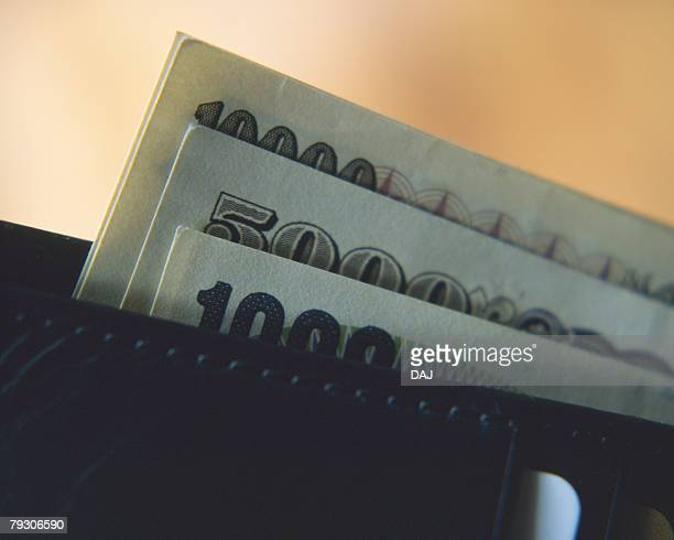 money and a wallet, close up - japanese yen note stock photos and pictures