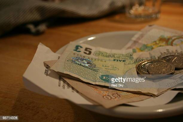 money and bill on the table after a meal