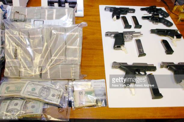Money and guns seized in a raid of an alleged heroin processing operation in Williamsburg Brooklyn are on display at a news conference on Tenth Ave...