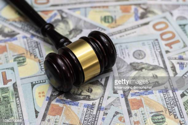 money and hammer,wooden gavel and dollar banknotes - せり売り ストックフォトと画像