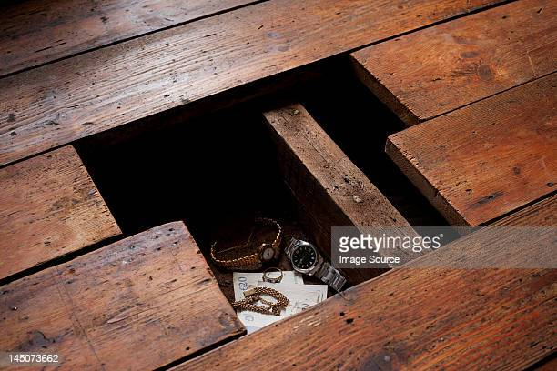 money and jewellery under floorboards - floorboard stock photos and pictures