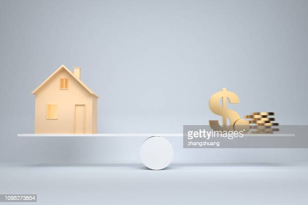 money and mortgage house - scales stock pictures, royalty-free photos & images