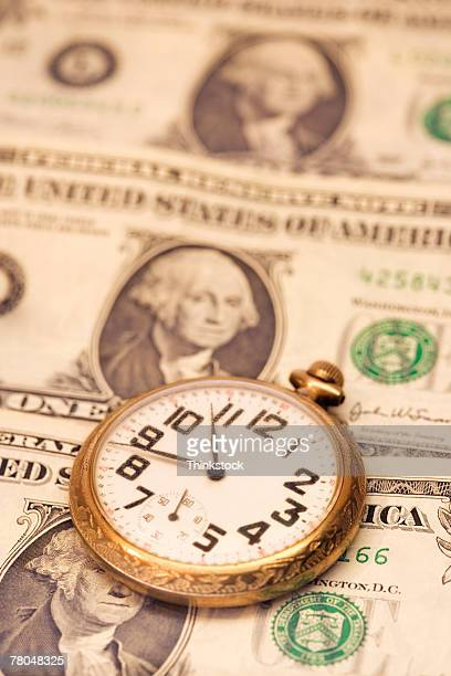 Money and pocket watch