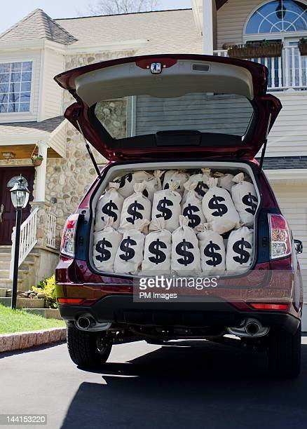 $ money bags in car trunk