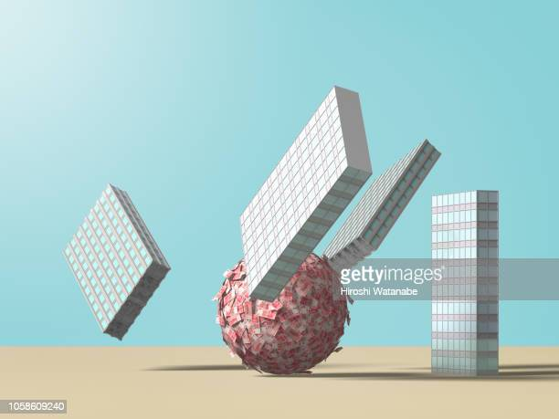 money ball knocks down office building dominos. ( chinese yuan ) - börsencrash stock-fotos und bilder