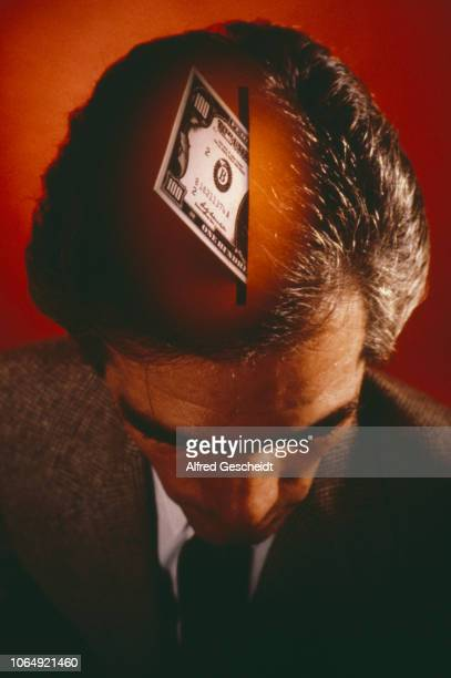 A money box detail superimposed on a man's head US 1981