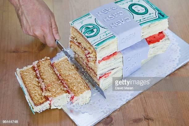 Money Cake Being Sliced