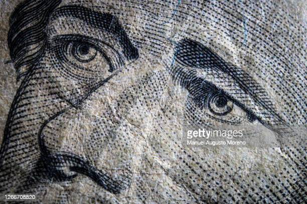money: close-up of the portrait of alexander hamilton on the us 10 dollar bank note - alexander hamilton stock pictures, royalty-free photos & images