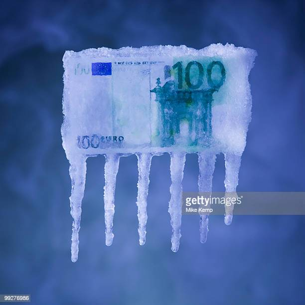 Money covered in ice