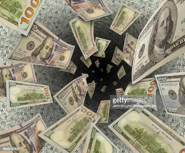 Money disappearing into vortex