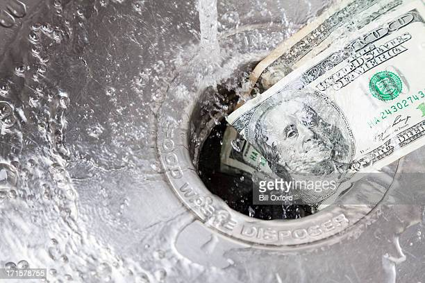 money down drain - politics concept stock pictures, royalty-free photos & images