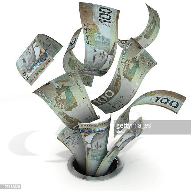 money down the drain - canadian dollars - canadian dollars stock pictures, royalty-free photos & images