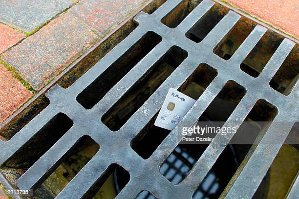 money down the drain - drain stock pictures, royalty-free photos & images