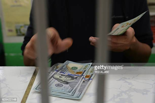 A Money Exchange Employee Counts Us Dollar Notes In Manila On November 24 2016 The