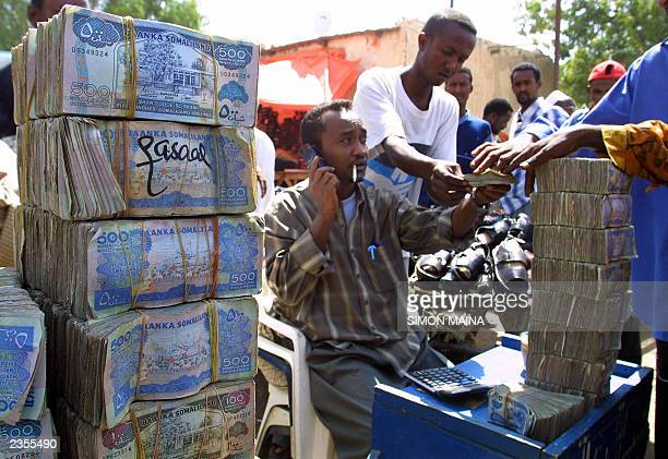A money exchanger doing his business in the busy streets of the Hargeisa market the capital of the breakaway republic of SomaliandUnemployment rate...