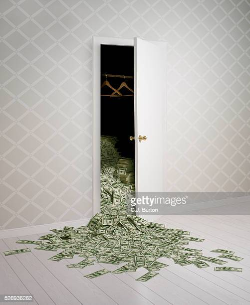 Money falling out of a closet