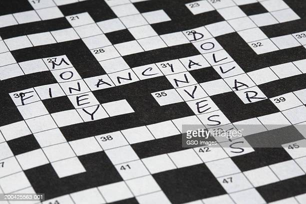 Money, financial, invests and dollar written on crossword