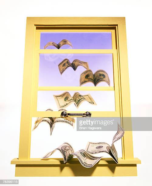Money flying out a window