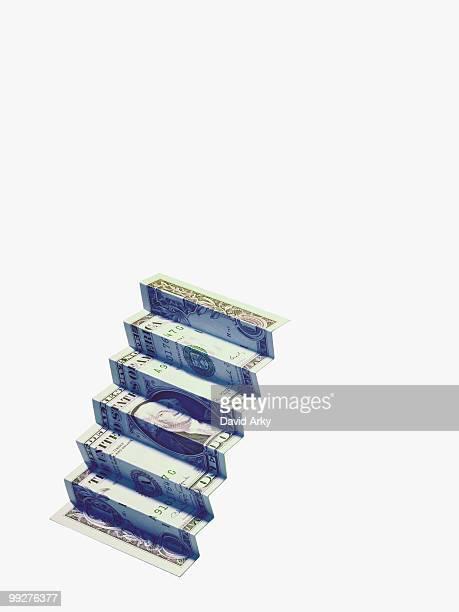 Money folded into shape of steps