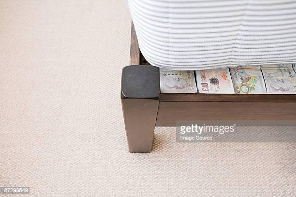 Money hidden under a mattress
