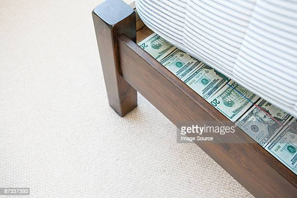 Money hidden under a mattress