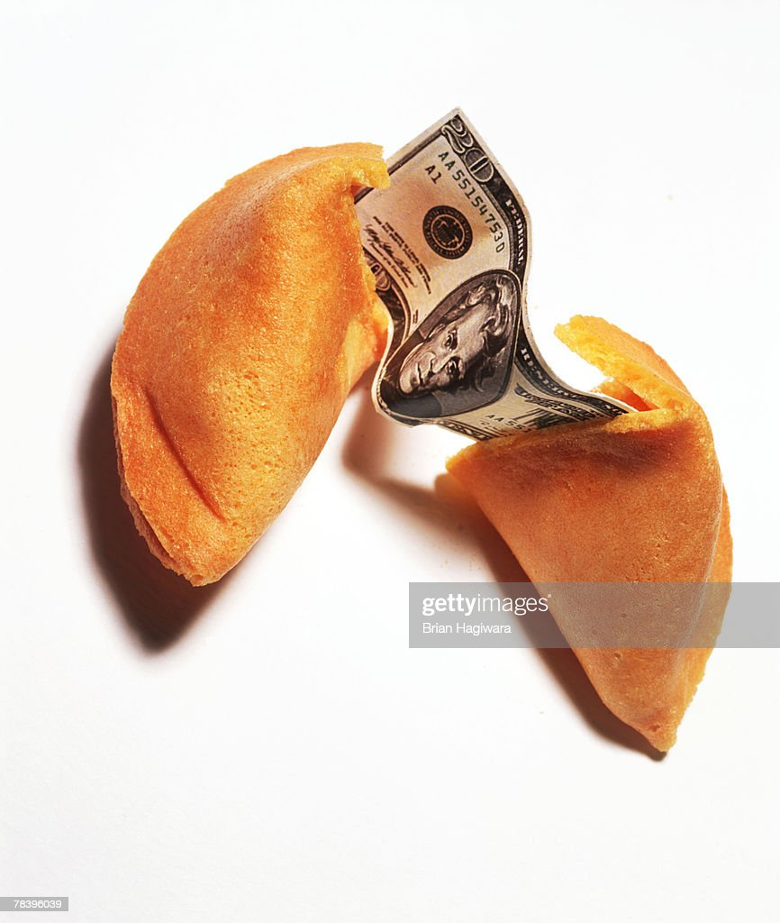 Money in fortune cookie : Stock Photo