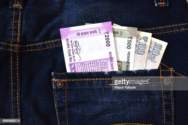 Money in jeans back pocket