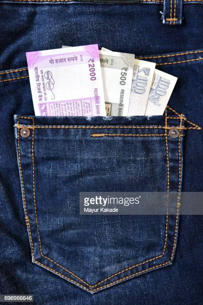 Money in jeans back pocket