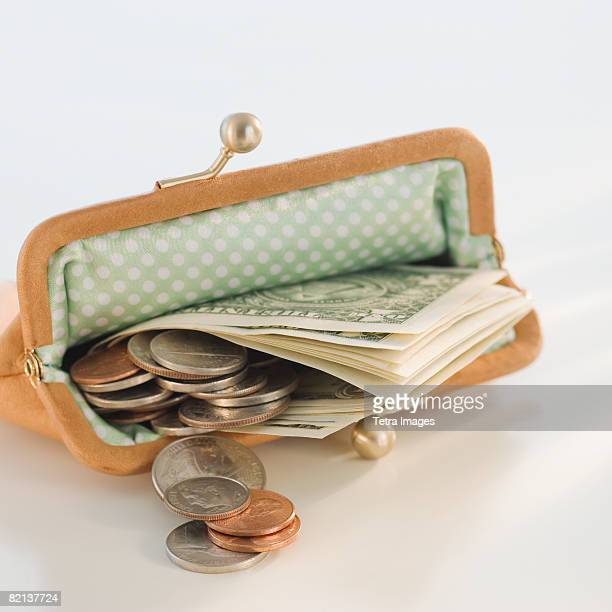 Money in open change purse