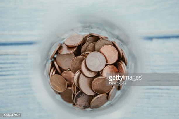 money jar filled with euro currency. savings and donations concept - donation box stock pictures, royalty-free photos & images