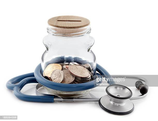 A money jar with a stethoscope wrapped around it isolated