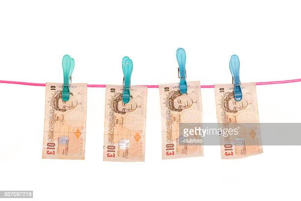 money laundering - uk pound - money laundering stock photos and pictures