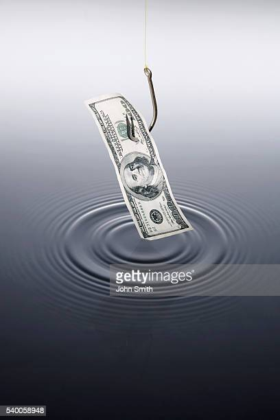 money on fishing hook - greedy smith stock pictures, royalty-free photos & images