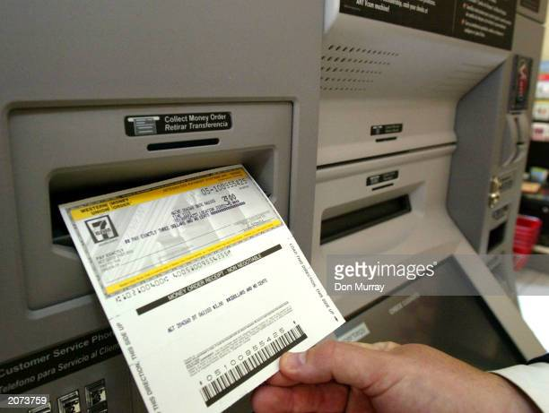 A money order is printed from a Vcom financial services kiosk at a 7Eleven store June 11 2003 in Philadelphia Pennsylvania Vcom is 7Eleven's new...