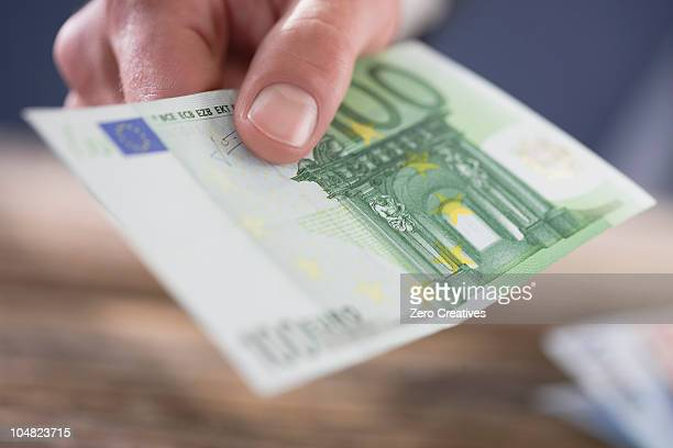 money - passing giving stock photos and pictures