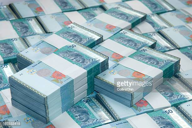 money pile - malaysian ringgit stock photos and pictures