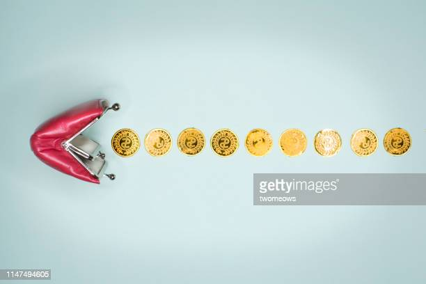 money saving concept image. - gold purse stock pictures, royalty-free photos & images