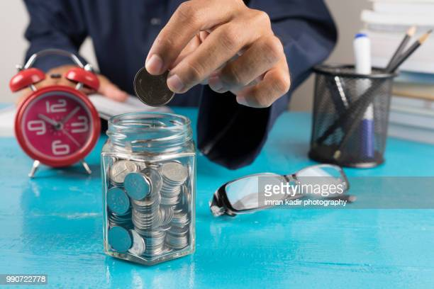 money saving concept - ira stock photos and pictures