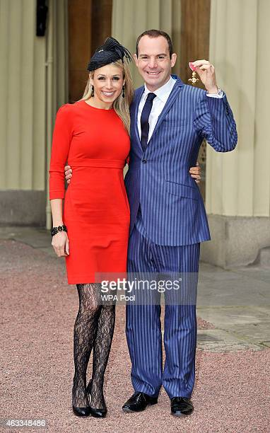 Money Saving Expert Martin Lewis with his Order of the British Empire medal presented to him by the Princess Royal alongside his partner Lara...